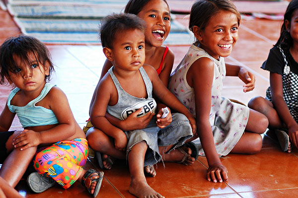 east-timor (timor-leste), dili, group of young happy asian children smiling.